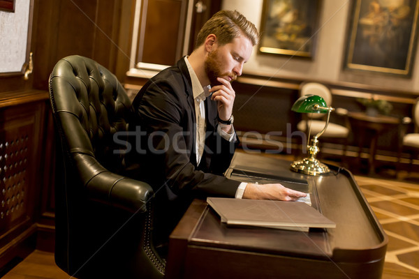 Young man in the workroom Stock photo © boggy