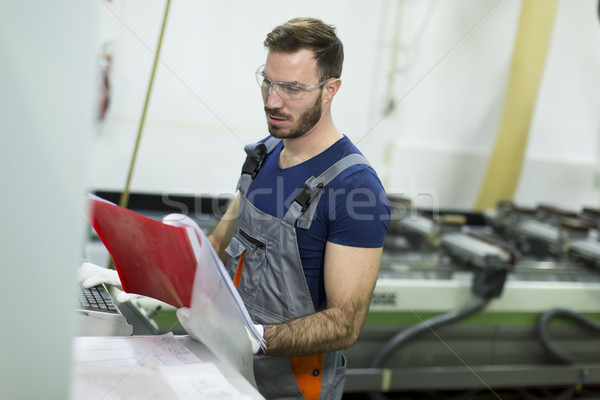 Young man works in factory Stock photo © boggy