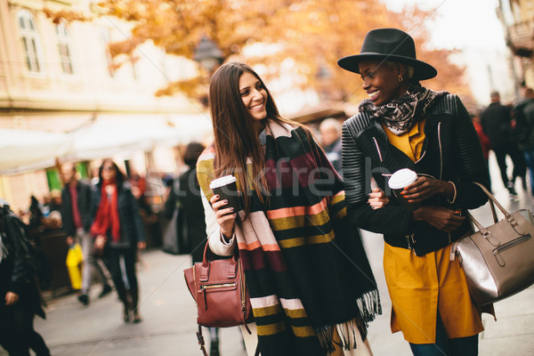 Multiracial modern women walking in the town Stock photo © boggy