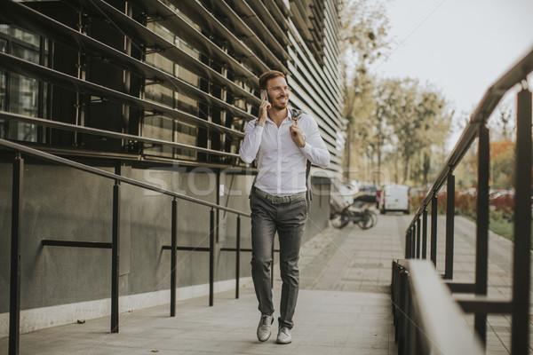 Elegante empresario caminando aire libre guapo jóvenes Foto stock © boggy