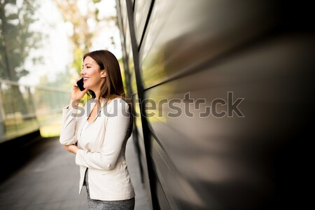 Laughing woman receiving tulips  flowers from her husband or par Stock photo © boggy