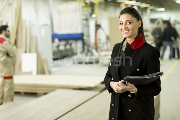 Female inspector at furniture industry Stock photo © boggy
