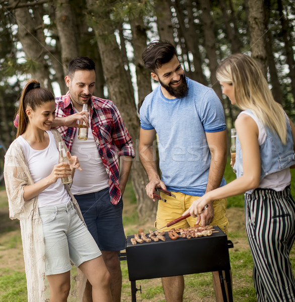 Stock photo: Young people enjoying barbecue party in park
