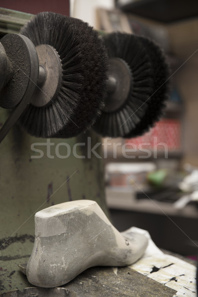 Shoe polisher in the shoemaker workshop Stock photo © boggy