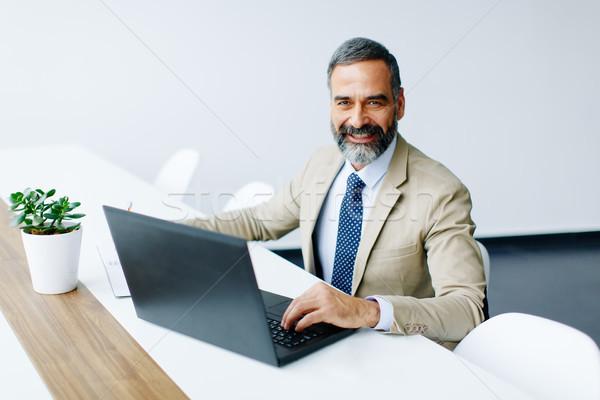 красивый бизнесмен рабочих ноутбука служба Сток-фото © boggy