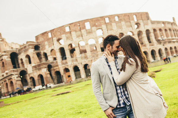 Loving couple in front of the Colosseum in Rome, Italy Stock photo © boggy