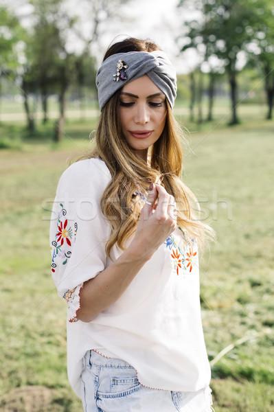 Retrato mulher jovem turbante cabeça posando ao ar livre Foto stock © boggy