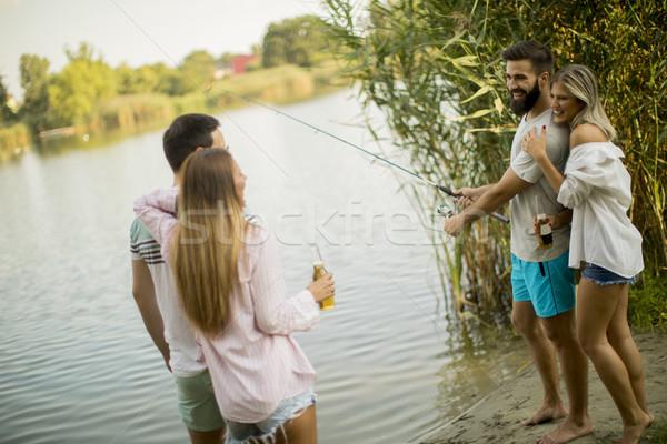 молодые люди наслаждаться рыбалки реке лет день Сток-фото © boggy