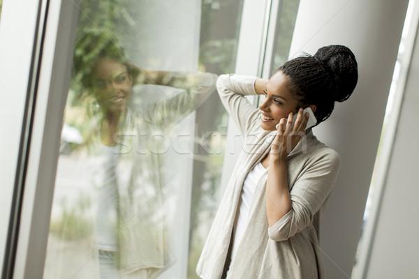 かなり 若い女性 オフィス 電話 作業 光 ストックフォト © boggy