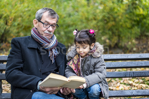 Grandfather and granddaughter in park Stock photo © boggy