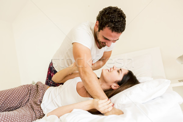Couple in bed Stock photo © boggy