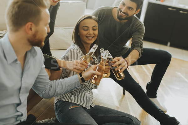 Young people drinking cider and have fun Stock photo © boggy