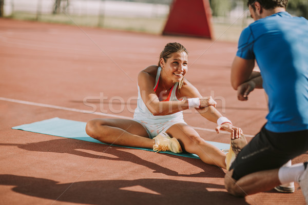 Vrouw opleiding personal trainer jonge vrouw sport Stockfoto © boggy