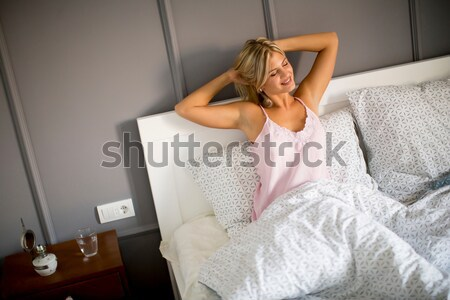 Young woman wake up in the morning Stock photo © boggy