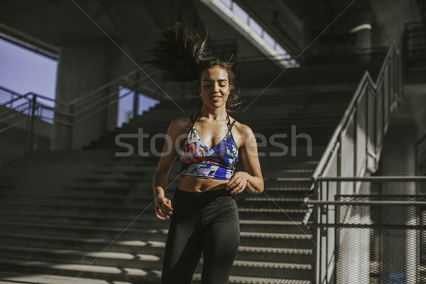 Young woman exercise in urban enviroment by day Stock photo © boggy