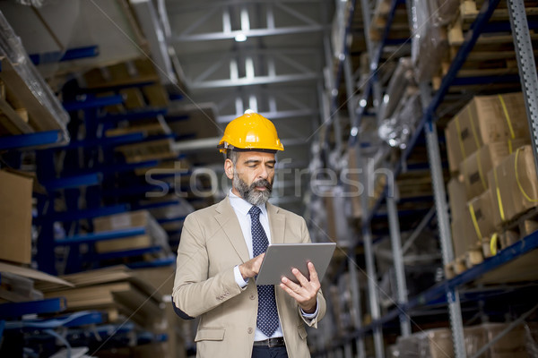 Empresario digital tableta fábrica retrato Foto stock © boggy