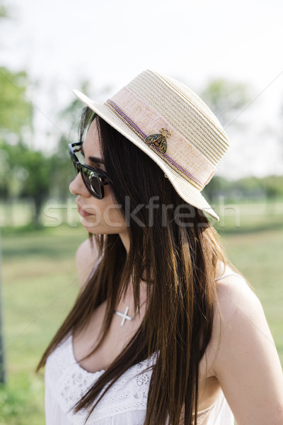 Stylish young woman in the park Stock photo © boggy