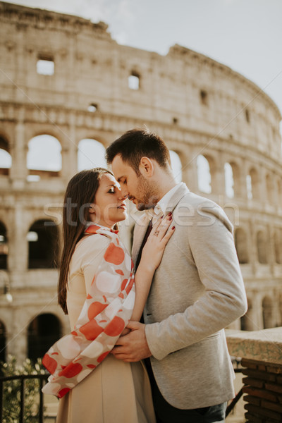 Loving couple visiting Italian famous landmarks Colosseum in Rom Stock photo © boggy