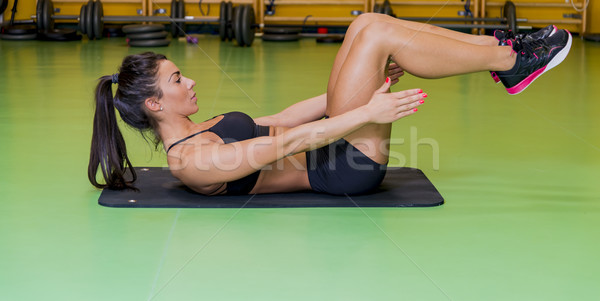 Mulher jovem abdominal exercer mulher esportes fitness Foto stock © boggy