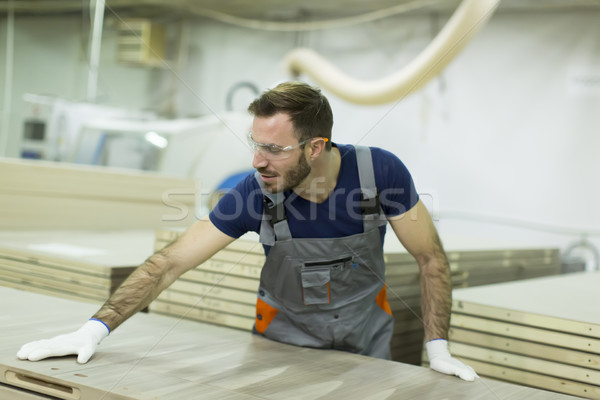 Handsome young man working in the lumber factory Stock photo © boggy