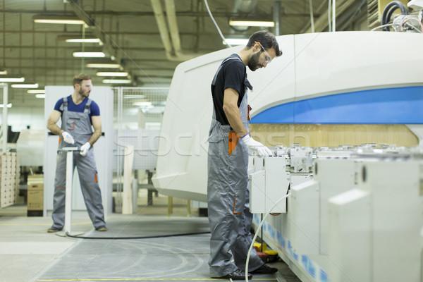 Jovem masculino trabalhadores trabalhar fábrica produção Foto stock © boggy