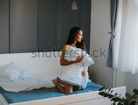 Pretty young woman in lingerie in bedroom Stock photo © boggy