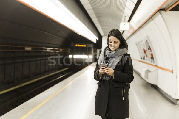 Young woman standing on a subway station, waiting for metro and  Stock photo © boggy