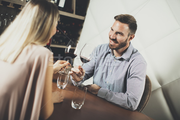 Handsome young couple on the date in wine bar Stock photo © boggy
