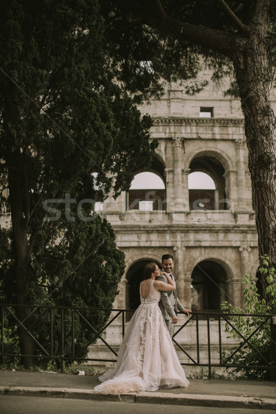 Young wedding couple by the Colosseum in Rome, Italy Stock photo © boggy