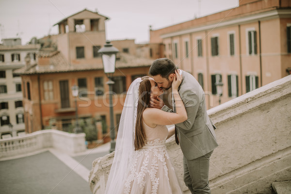Young wedding couple on Spanish stairs in Rome, Italy Stock photo © boggy