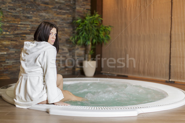 Young woman in hot tub Stock photo © boggy