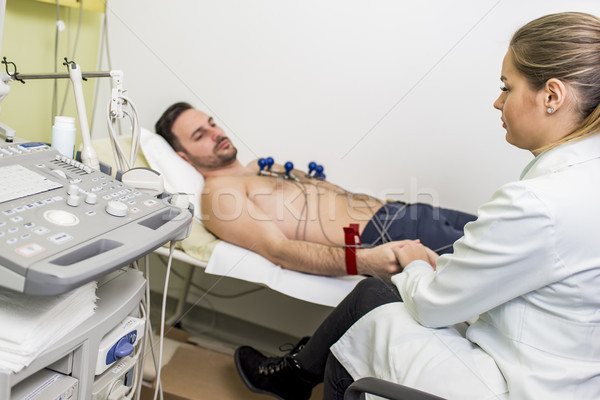 Young man doing EKG in hospital Stock photo © boggy