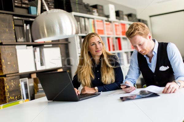 Portrait of woman with male colleague working in office Stock photo © boggy