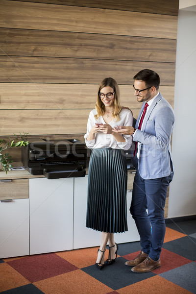 Business people talking in office by the scanner mashine Stock photo © boggy