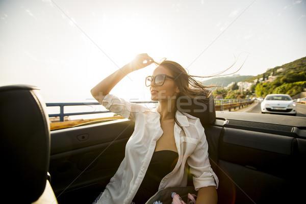 Genç kabriyole sahil görmek kadın Stok fotoğraf © boggy