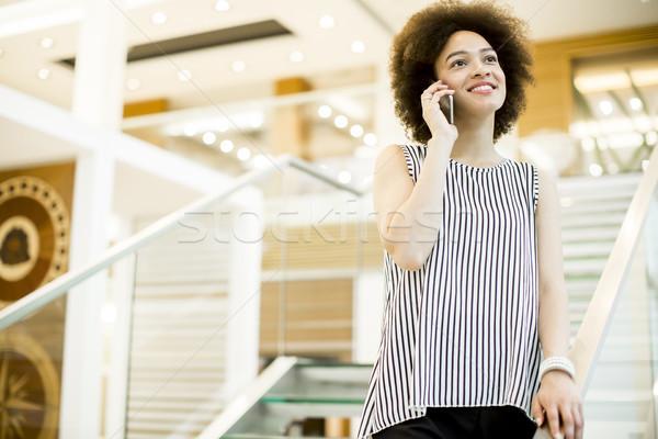 Sonriendo mujer de negocios teléfono móvil oficina Foto stock © boggy