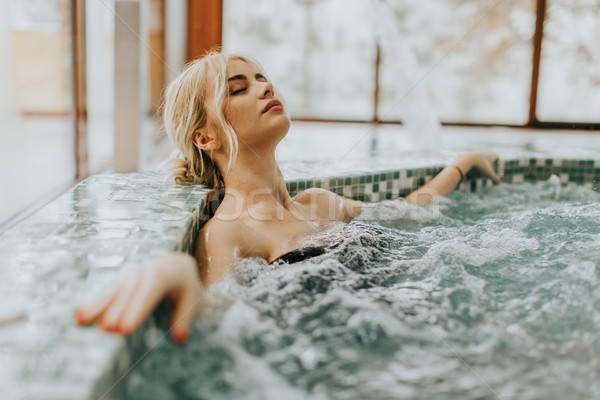 Young woman relaxing in the whirlpool bathtub Stock photo © boggy