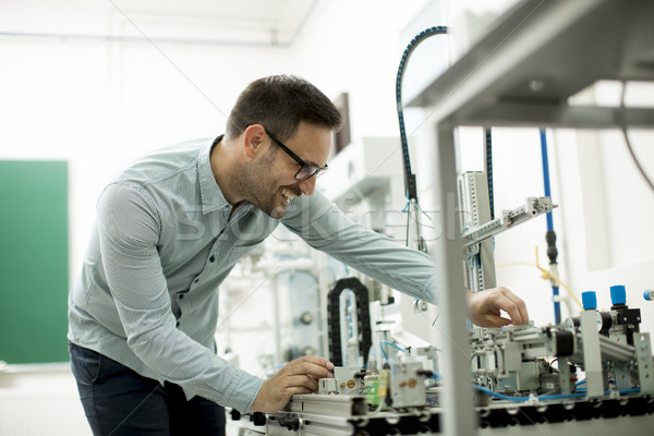 Handsome young man in the electronic workshop Stock photo © boggy