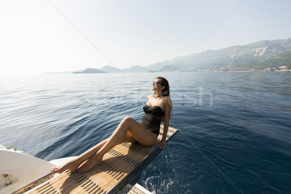 かなり 若い女性 リラックス ヨット 海 ストックフォト © boggy