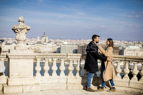 Stock photo: Couple in love hugging of the magnificent landscape view of Buda
