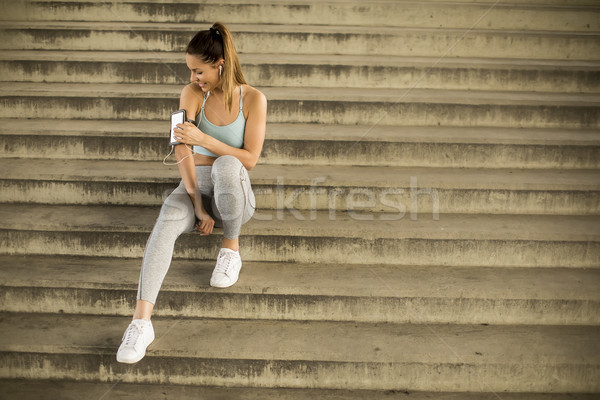 Young female runner resting on stirs Stock photo © boggy