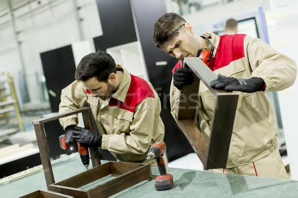 Deux jeunes hommes travail usine production meubles Photo stock © boggy