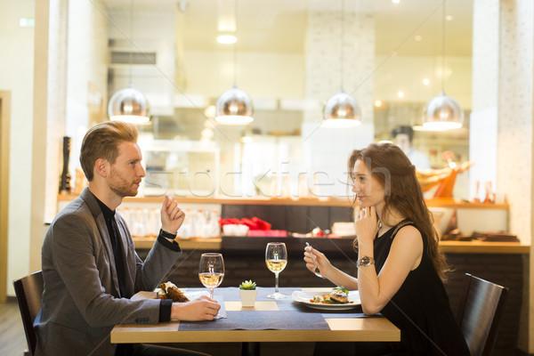 Sorridere Coppia mangiare ristorante felice Foto d'archivio © boggy