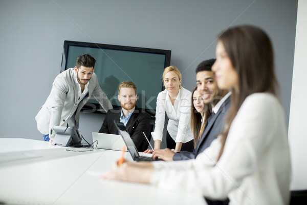 Business team working together to achieve better results Stock photo © boggy