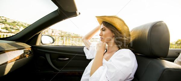 Jovem mulher atraente cabriolé beira-mar ver transporte Foto stock © boggy