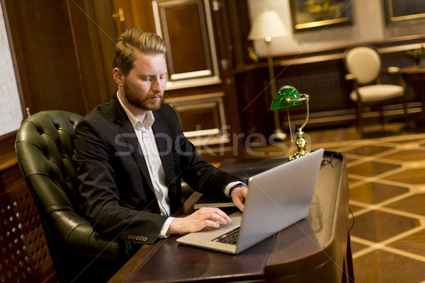 Young business man in workroom Stock photo © boggy