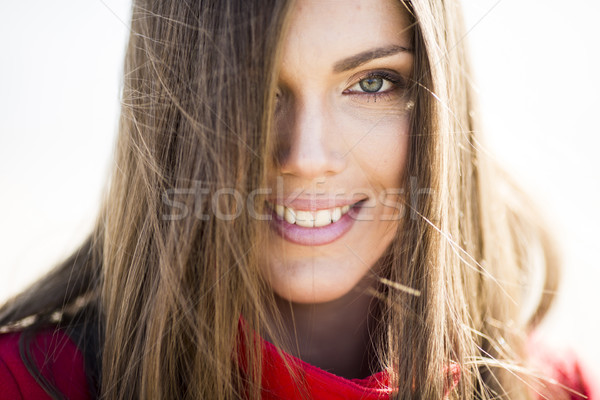 Pretty young longhair woman in the coat Stock photo © boggy