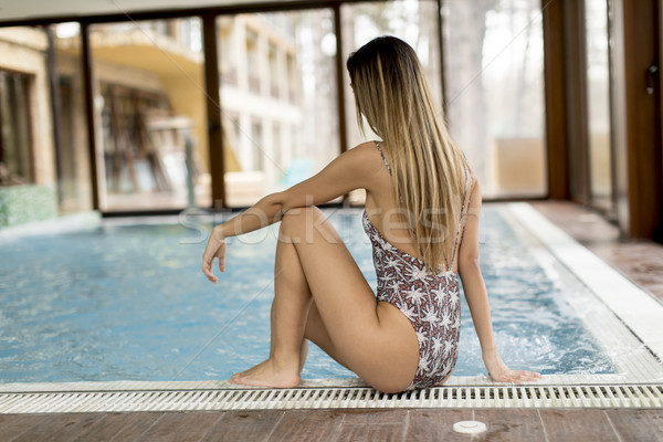 Young woman relaxing by pool side Stock photo © boggy