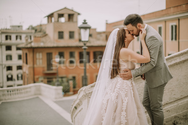 Young newly married couple  posing in Rome with beautiful and an Stock photo © boggy