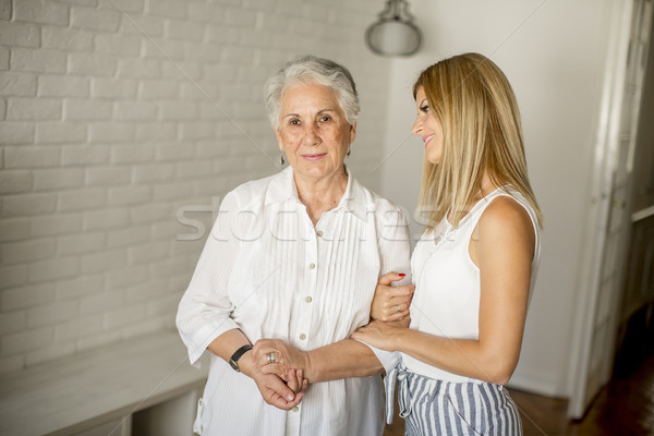 Grandmother and granddaughter posing in the room Stock photo © boggy